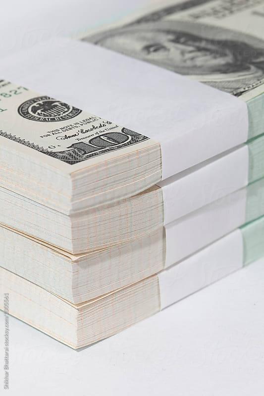 close up of stack of us dollars. by Shikhar Bhattarai for Stocksy United