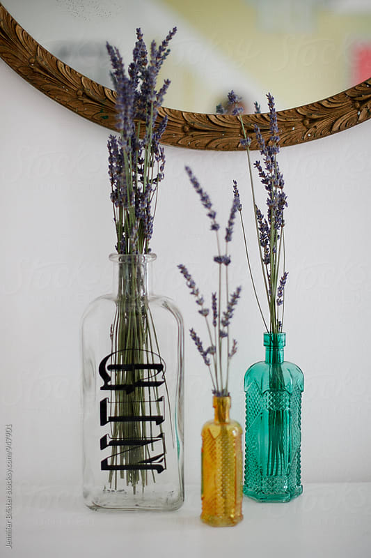 vintage bottles with lavender  by Jennifer Brister for Stocksy United