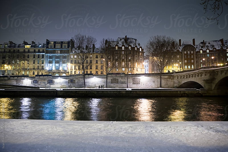 River Seine in Paris on a winter night by Ivan Bastien for Stocksy United