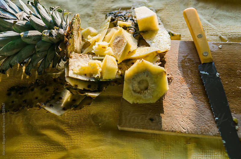 Fresh pineapple peel on a table by Alessio Bogani for Stocksy United