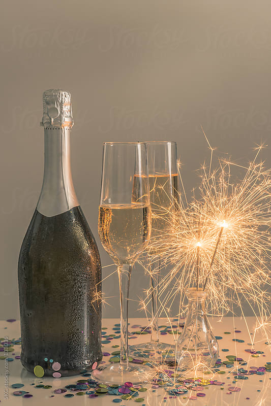 Moody Lighting at a Party with Champagne and Sparklers by suzanne clements for Stocksy United