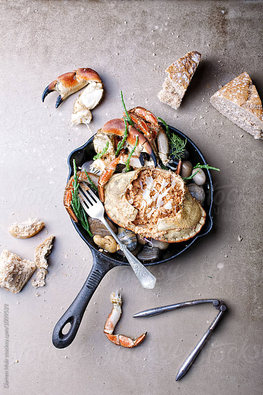 Dressed crab served with crusty bread.Crab meal. by Darren Muir for Stocksy United