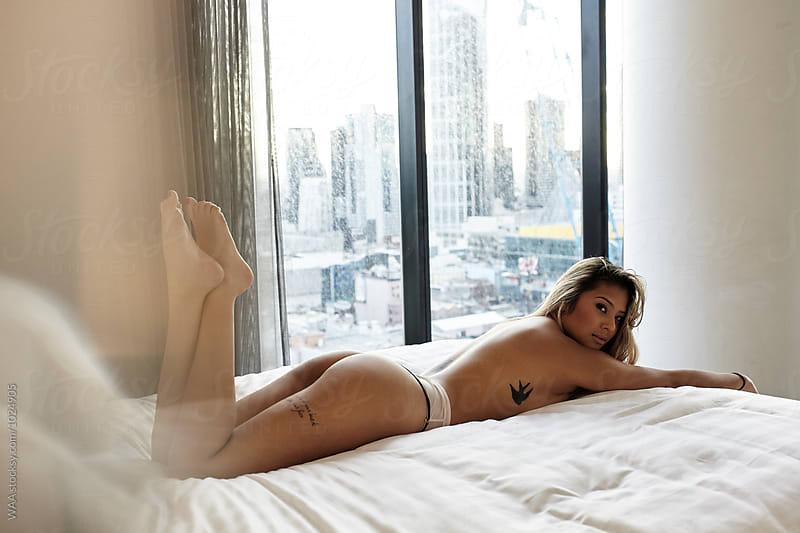 Female in Underwear on Bed by WAA for Stocksy United