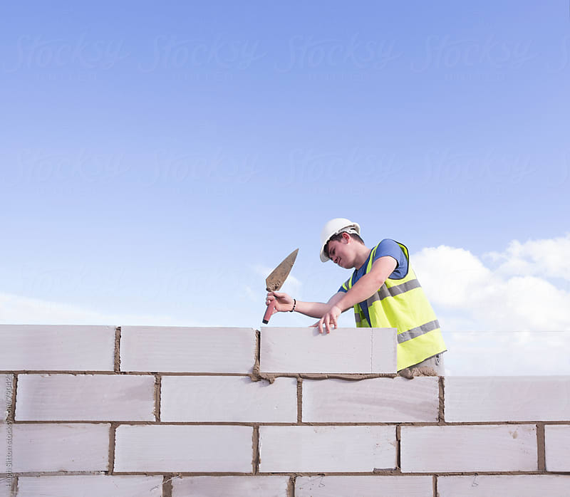 Apprentice Bricklayer. by Hugh Sitton for Stocksy United