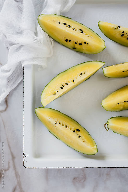 Yellow watermelon by Tatjana Zlatkovic for Stocksy United