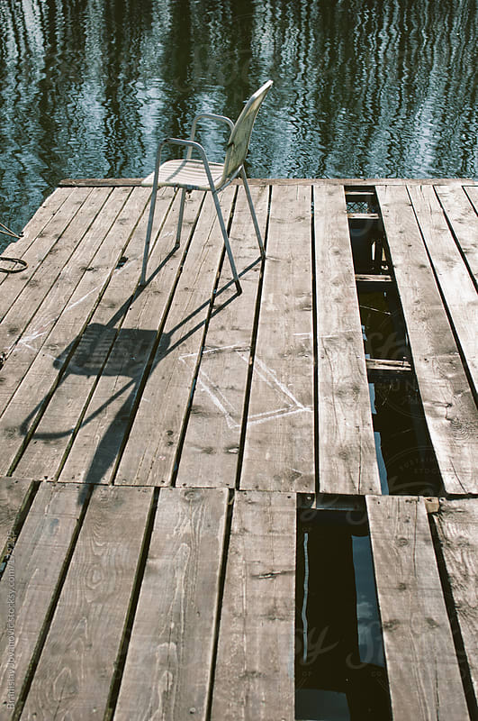 Chair on dock by Brkati Krokodil for Stocksy United