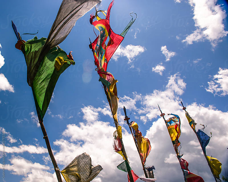 Prayer flags at Taktsang Lhakhang, Bhutan by Gabriel Diaz for Stocksy United