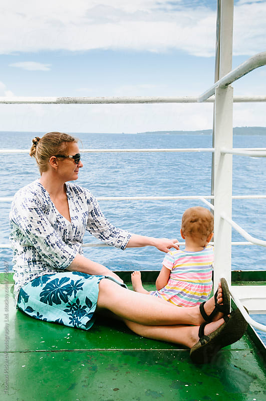 Mother and daughter on ferry Samoa. by Thomas Pickard for Stocksy United