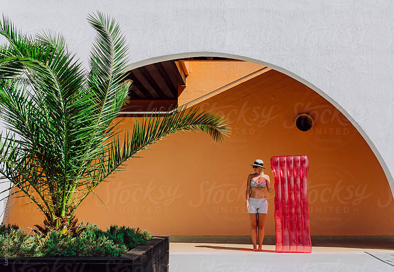 Woman With a Sea Mattress at a Beach Hotel by Lumina for Stocksy United