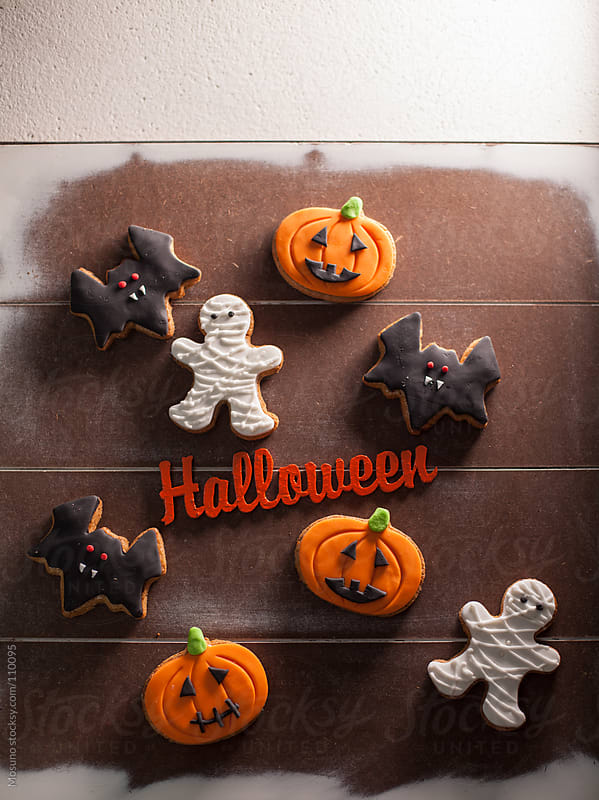 Halloween Cookies on a Wooden Background by Mosuno for Stocksy United