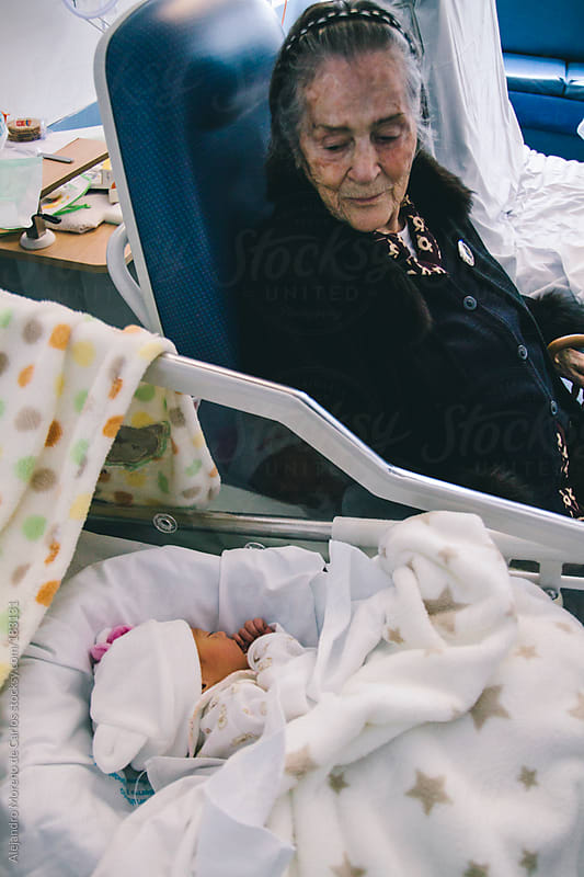 Great grandmother visiting her granddaughter newborn baby at hospital by Alejandro Moreno de Carlos for Stocksy United