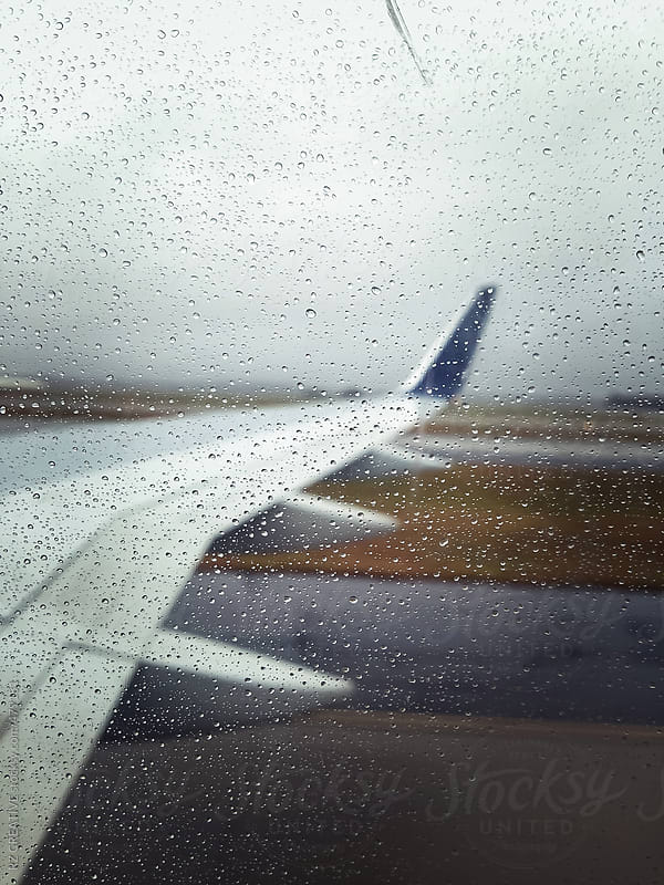 Water drops on the window of a commercial airliner captured with mobile phone. by RZ CREATIVE for Stocksy United