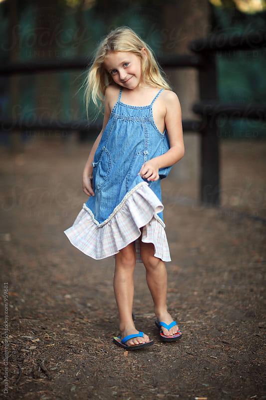 Blonde Girl Holding Edge of Her Denim Dress by Dina Giangregorio for Stocksy United