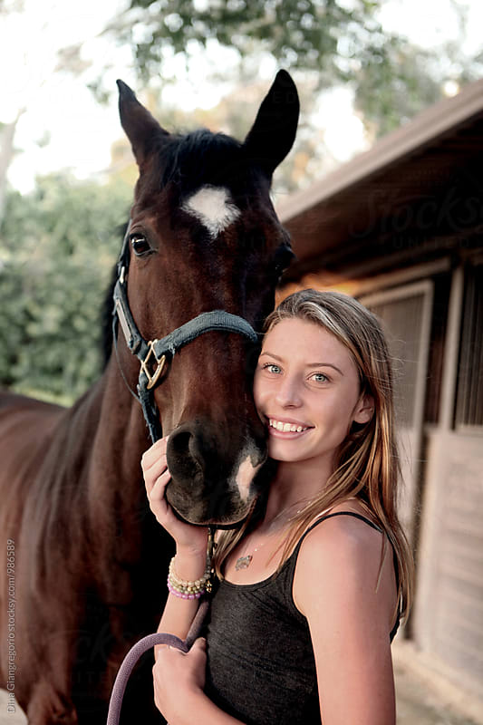 Beautiful Teenager With Her Horse by Dina Giangregorio for Stocksy United