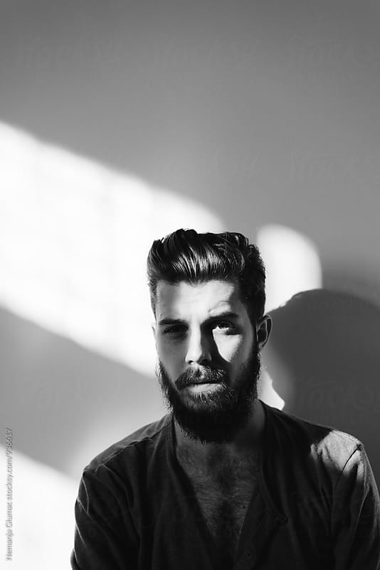 Black and White Portrait of a Bearded Handsome Man by Nemanja Glumac for Stocksy United