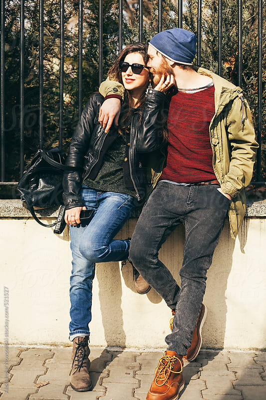 Young couple on the street - enjoying the sunlight by Aleksandar Novoselski for Stocksy United