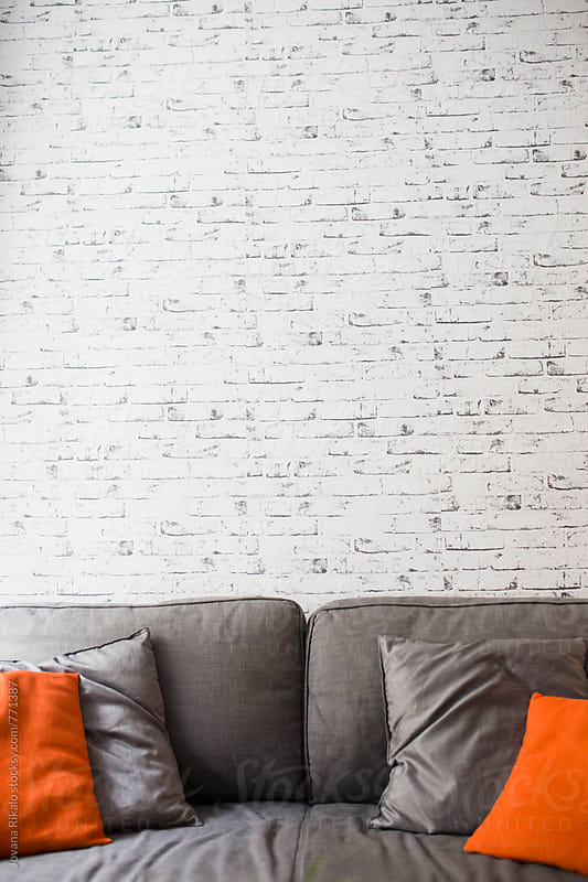 Modern living room with white brick wall by Jovana Rikalo for Stocksy United