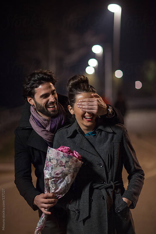 Man Surprises Woman on a Valentine's day. by Mosuno for Stocksy United