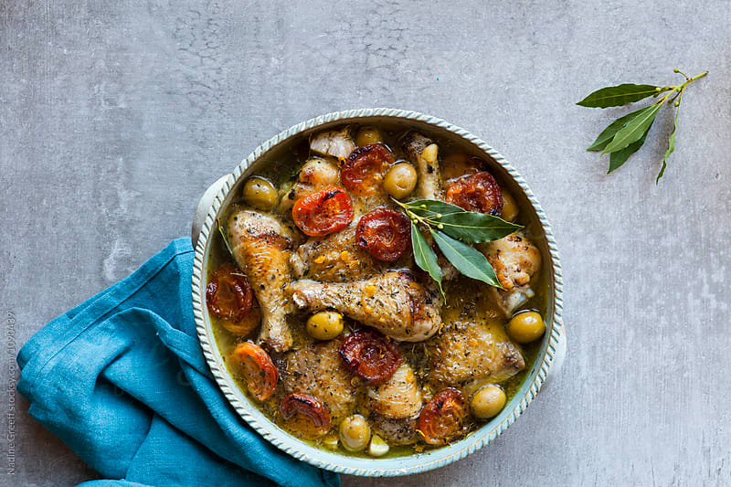 Chicken tagine with apricots, green olives and bay leaves by Nadine Greeff for Stocksy United
