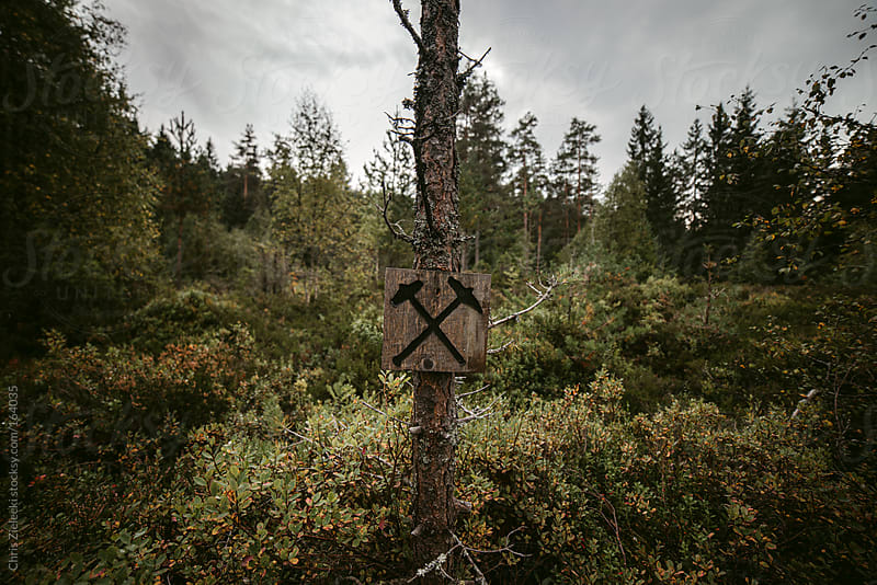mining sign in the woods by Christian Zielecki for Stocksy United