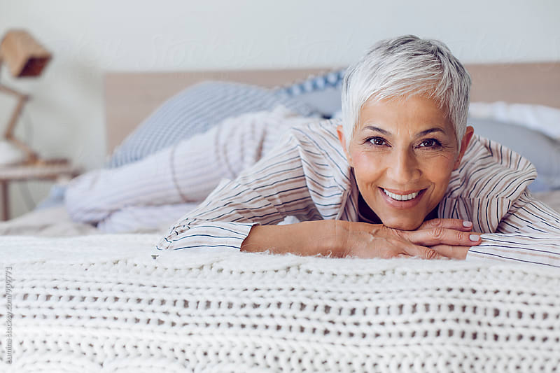 Caucasian Senior Woman Relaxing in Bed by Lumina for Stocksy United