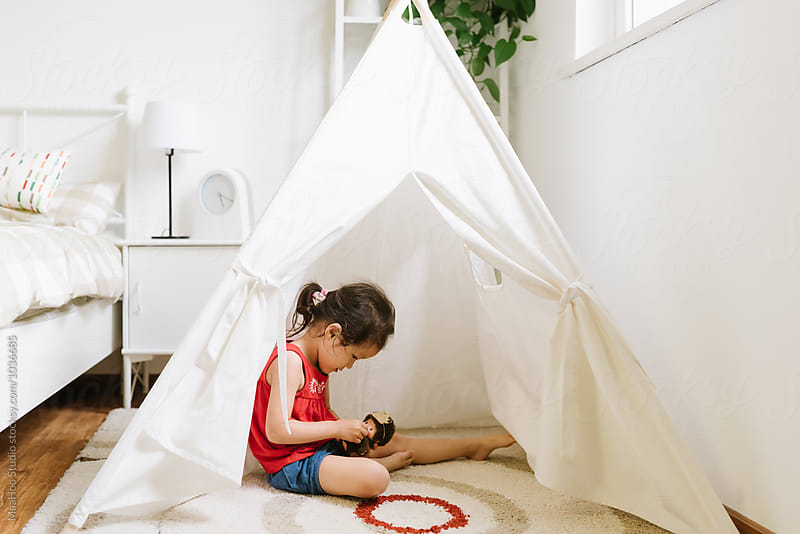 Cute little girl playing in teepee tent by Maa Hoo for Stocksy United