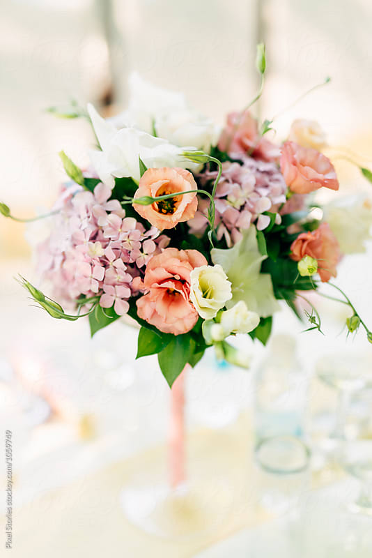Beautiful flower bouquet on wedding table by Pixel Stories for Stocksy United