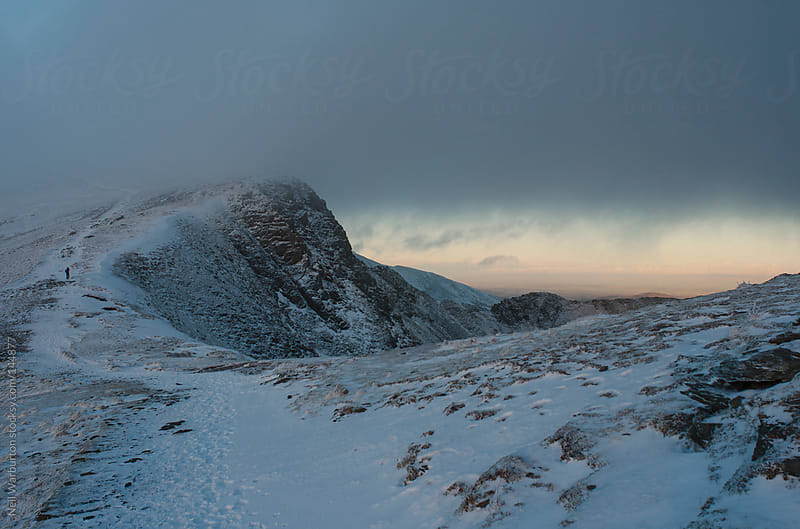 Clouded Summit Near Sunset by Neil Warburton for Stocksy United