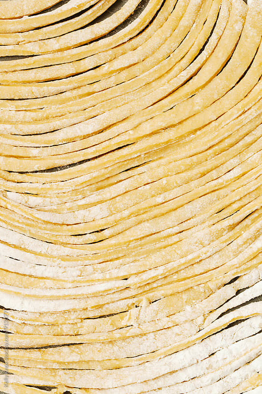 vertical image of homemade, uncooked pasta by Kelly Knox for Stocksy United