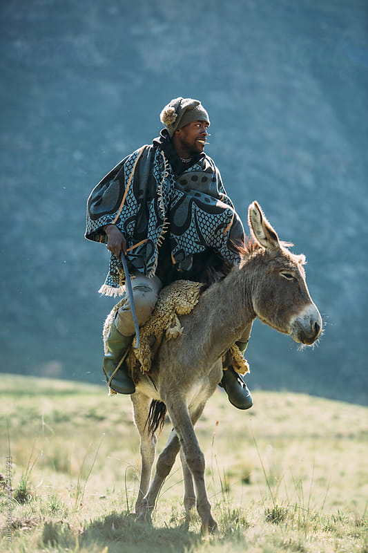 Basotho muleteer on his donky by Micky Wiswedel for Stocksy United