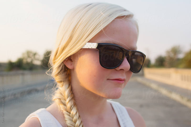 young girl wearing sunglasses by Tana Teel for Stocksy United