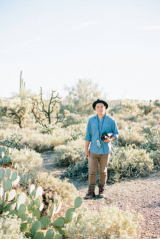 Man standing in desert by Daniel Kim Photography for Stocksy United