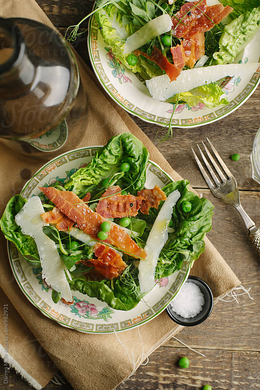 Pea,bacon and parmigiano salads. by Darren Muir for Stocksy United