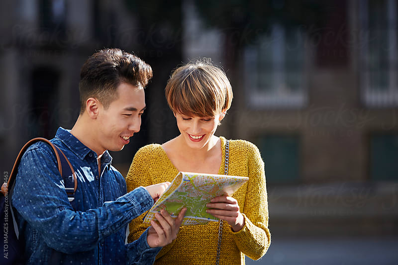 Couple Looking At Map In City On Sunny Day by ALTO IMAGES for Stocksy United
