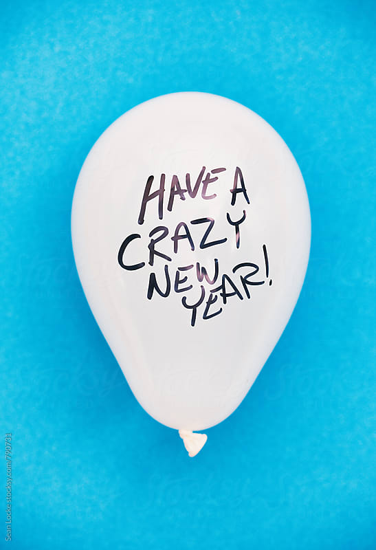 NYE: Balloon Tells You To Have A Crazy New Year by Sean Locke for Stocksy United