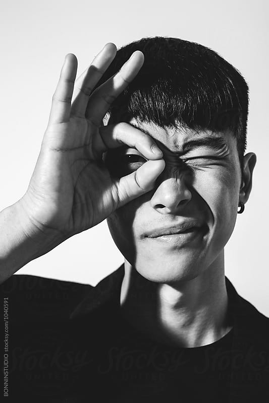 Portrait of young asian man in black and white. by BONNINSTUDIO for Stocksy United