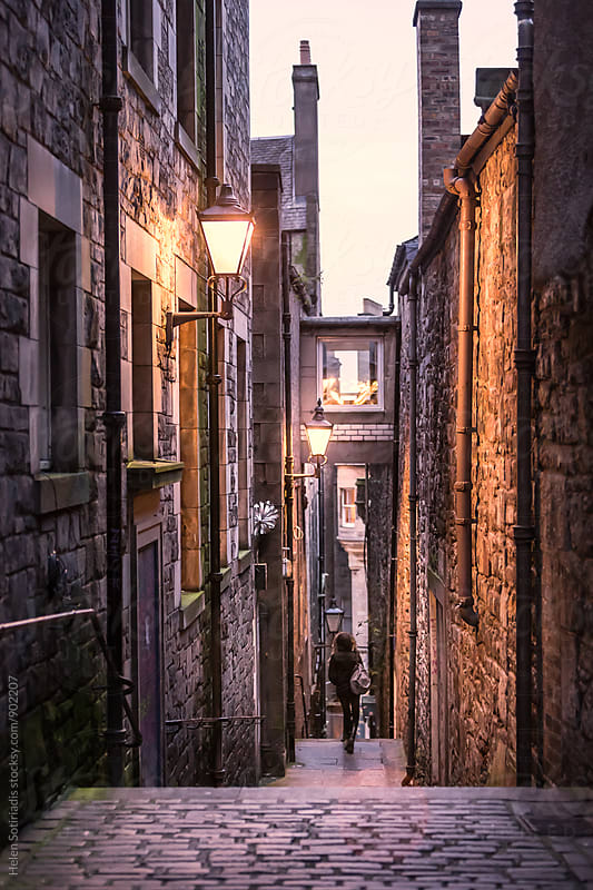 Exploring a Narrow Edinburgh Street in the Evening by Helen Sotiriadis for Stocksy United