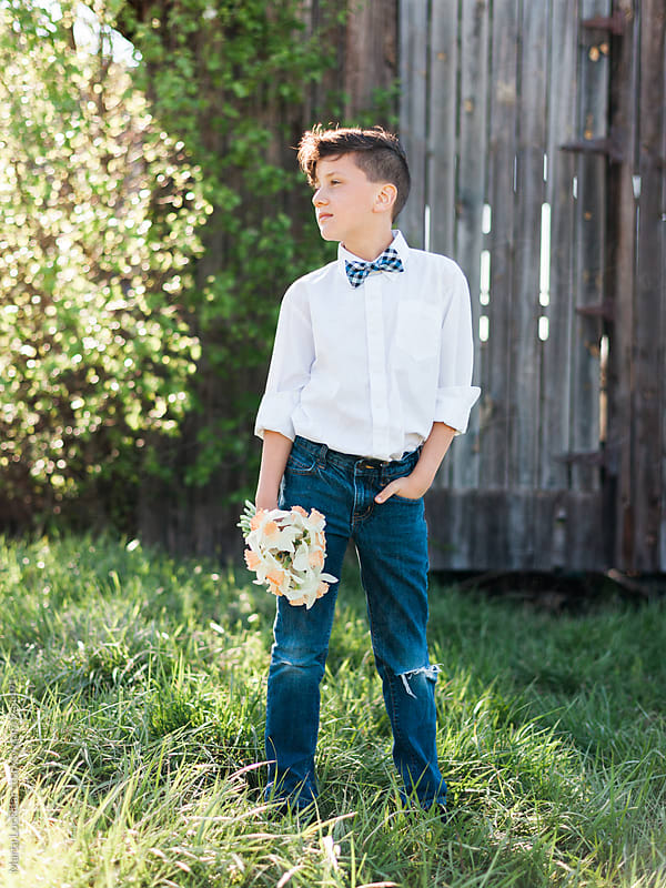 Boy in bow tie with a bouquet of Daffodils by Marta Locklear for Stocksy United