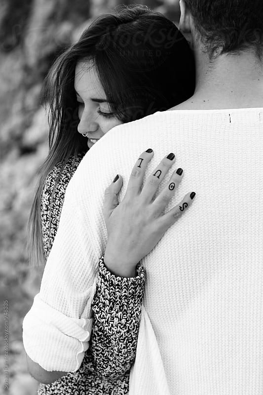 Woman hugging her boyfriend by Susana Ramírez for Stocksy United