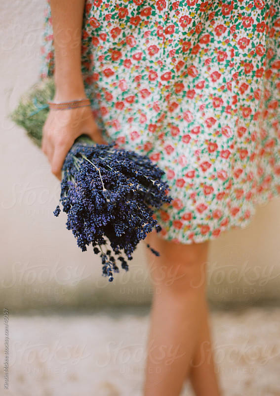 Girl holding lavender by Kirstin Mckee for Stocksy United