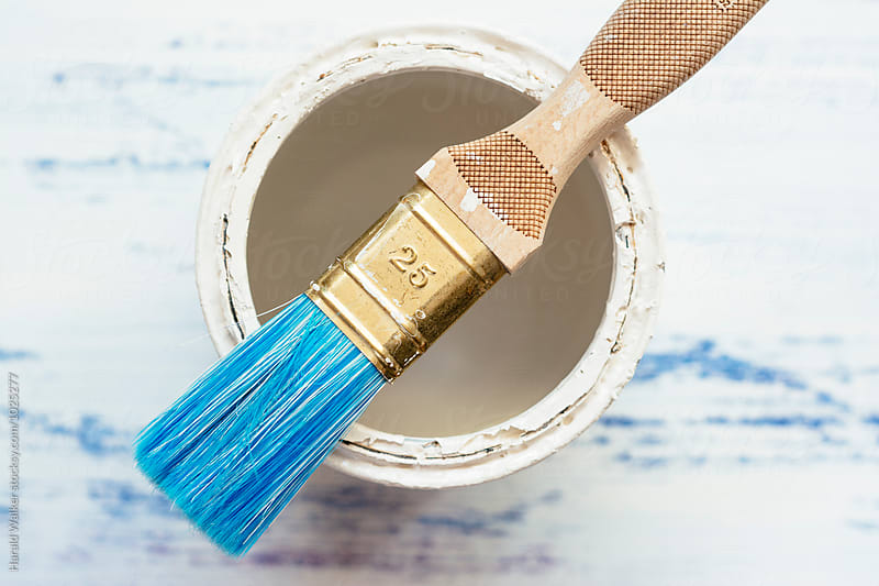 Paint brush with can by Harald Walker for Stocksy United