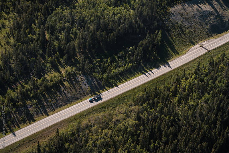 A semi truck on a mountain highway from above by Riley Joseph for Stocksy United
