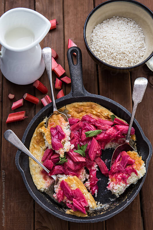 Baked Rice Pudding in a skillet pan with three spoons by Aniko Lueff Takacs for Stocksy United