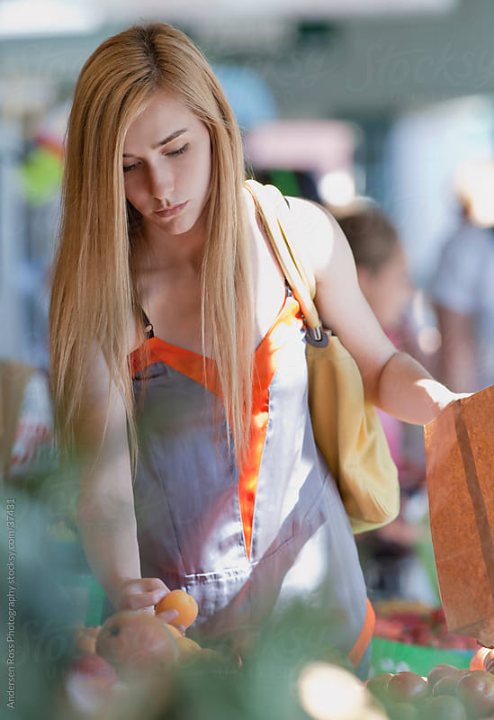 Young woman shopping for fruit by Andersen Ross Photography for Stocksy United