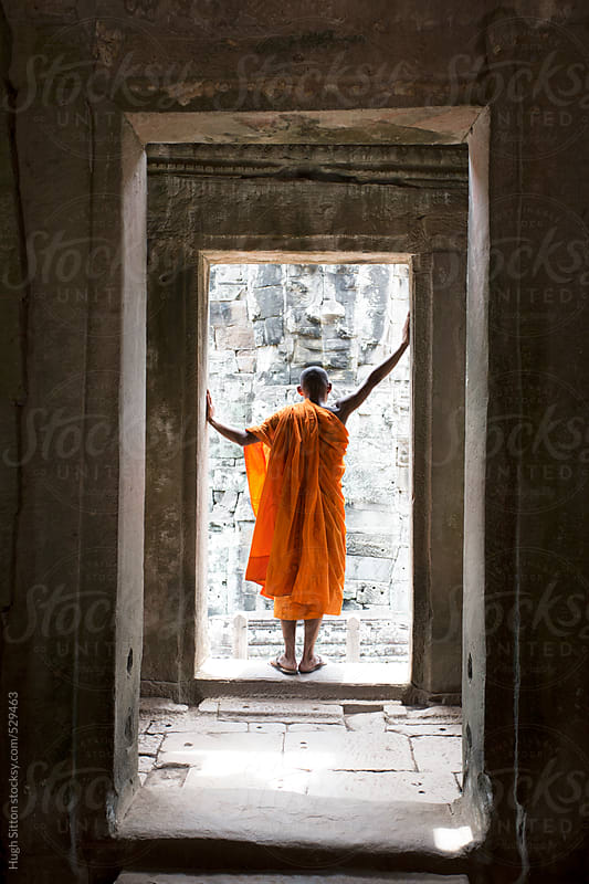 Buddhist monk at Bayon Temple. Angkor Wat. Cambodia. by Hugh Sitton for Stocksy United