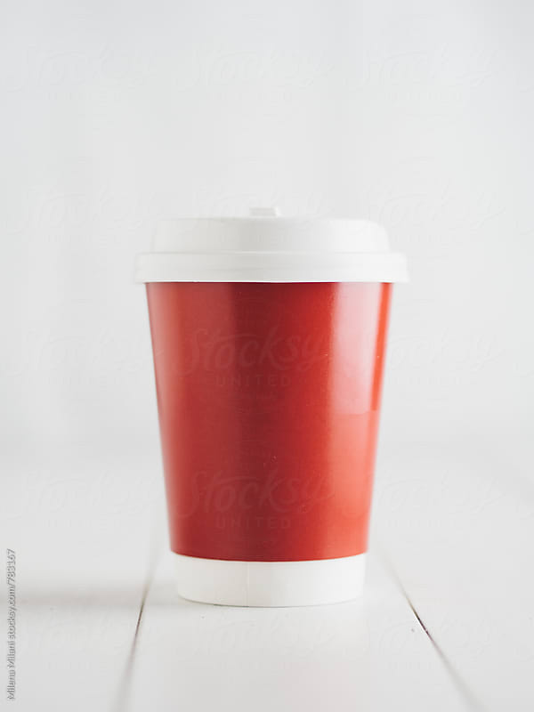 Red paper cup by Milena Milani for Stocksy United