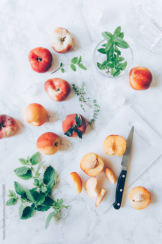 Peaches on a marble table by Nataša Mandić for Stocksy United