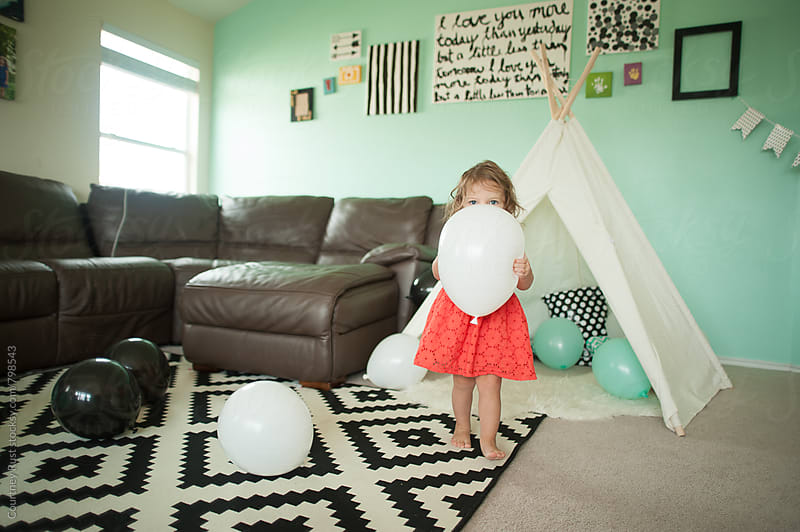 Girl with party balloon by Courtney Rust for Stocksy United