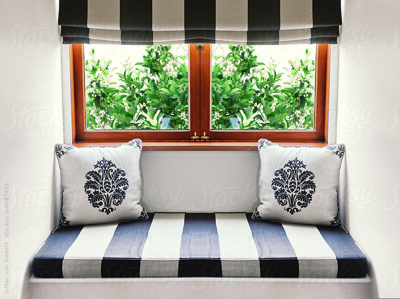 home interior, window seat by Gillian Vann for Stocksy United