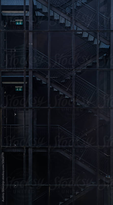 Industrial staircase/facade detail. by Audrey Shtecinjo for Stocksy United